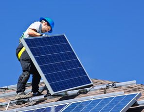 engineer installing a solar panel